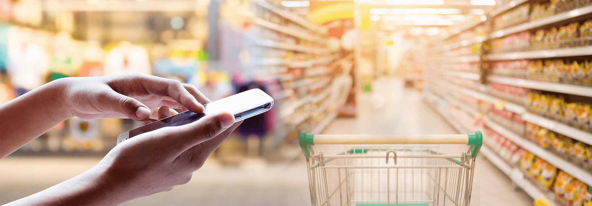Téléphone et caddy supermarché